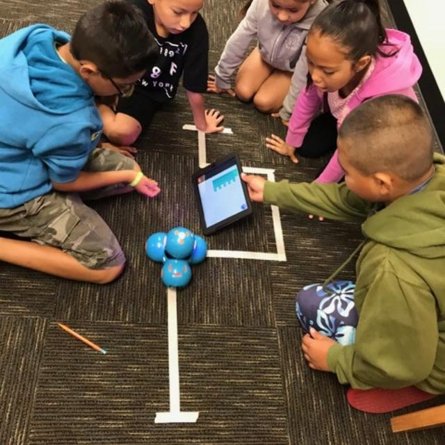 Scholars learn how to code robotics movements.